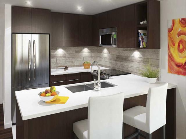 Sleek white quartz countertops rockwell countertops for Custom made kitchen countertops